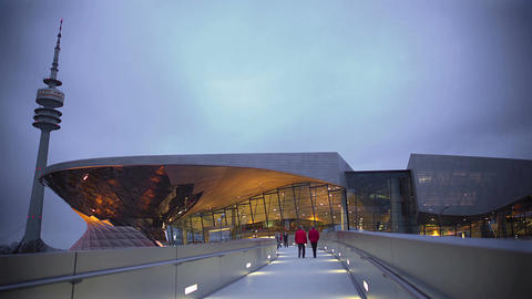 People walking toward new glass shopping center on weekend, modern architecture Footage