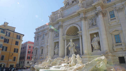 Poli Palace and popular Trevi fountain in Rome, Italy on a sunny summer day Footage