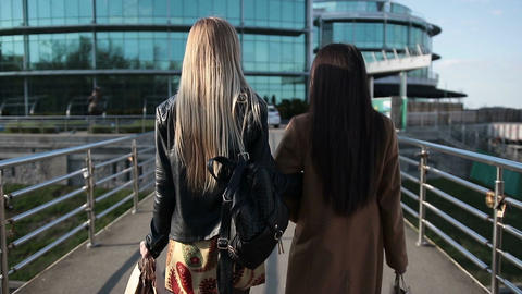Shopping women walking on pedestrian bridge Footage
