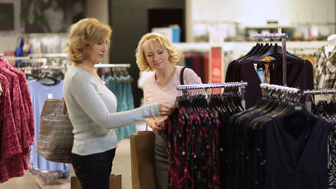 Woman selecting apparel while shopping for clothes Footage