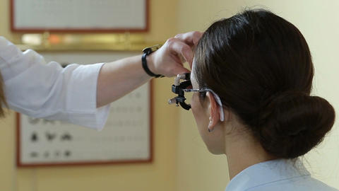 Optometrist doctor examining eyesight of patient Footage