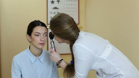 Doctor with ophthalmoscope examining patient eyes Footage