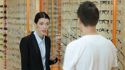 Optometrist consulting customer about spectacles Live Action