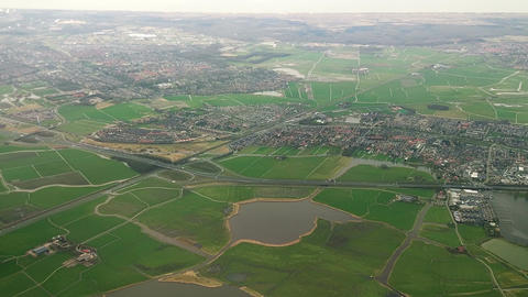 The plane flies over Netherlands on approaching the Amsterdam Filmmaterial