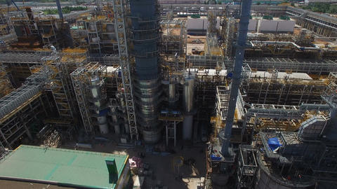 Aerial View of Oil Refinery Construction Site with Shiny Pipes Footage