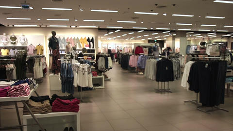 Interior of fashionable shop with different clothes Footage