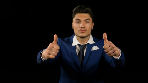 Joyful young business man showing thumbs up Footage