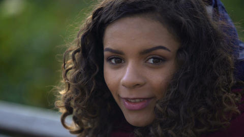 Beautiful biracial woman posing for camera and smiling sincerely, face close-up Footage