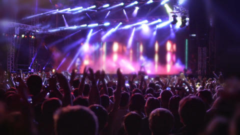 People jumping and waving hands, enjoying favorite music and songs at concert Footage