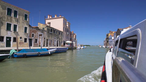 Water taxi bus carrying tourists along Grand Canal, leisure trip around Venice Footage