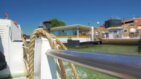 Thick rope tied on board of motor boat cruising canal, water transport services Footage