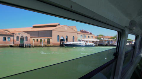 Famous Faro di Murano lighthouse, view through water bus window, trip to Venice Footage