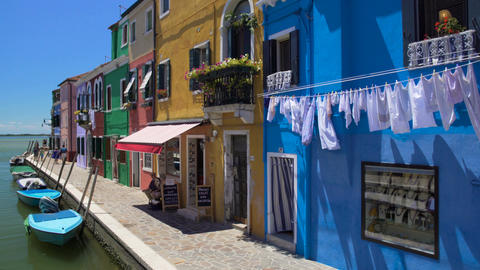Nice brightly colored houses on Burano island, Italian place of tourist interest Footage