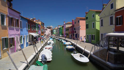 Many tourists viewing brightly colored houses in Burano island street, Venice Footage