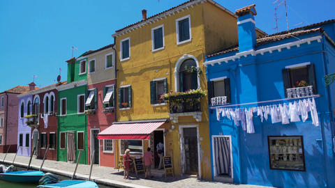 Men and women entering nice cafe on colorful Burano island, travel to Venice Footage
