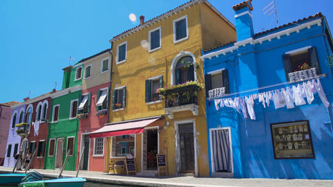 Crowd of tourists viewing colorful architecture of Burano island from bridge Footage