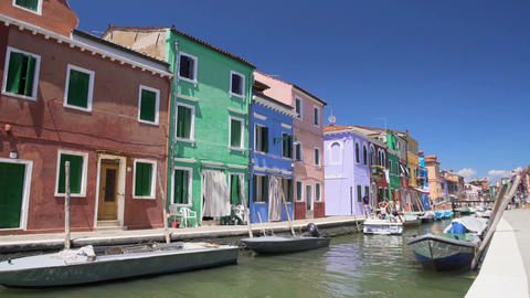 Sunny day on Burano island, nice coloured houses along canal, summer tourism Footage