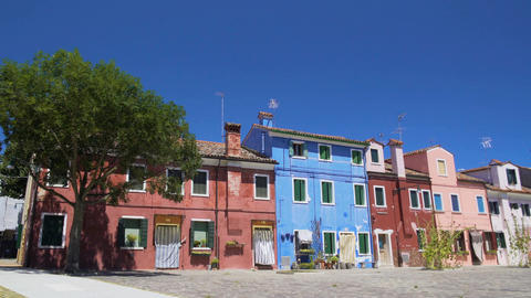 Brightly colored houses with doors and windows shut, hot summer on sunny Burano Footage