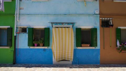 Nice blue home in multicolored street of Burano island, cozy Italian house Footage