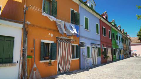 Colorfully painted buildings, street on Burano island, Italian architecture Footage