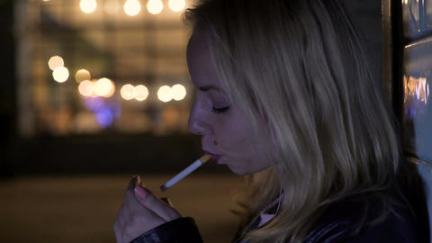 Depressed woman smoking and thinking about breakup,... Stock Video Footage