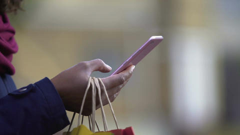 Woman adding desired goods to cart in online store applications, mobile shopping Filmmaterial