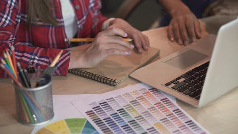 Designer and decorator working on project, drawing sketches, proposing ideas Footage