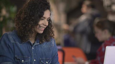 Beautiful mixed race woman making video call on laptop, modern technologies Footage