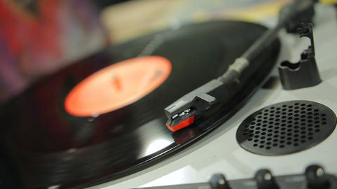 Vinyl record spinning on retro music player at vintage musical instruments store Footage