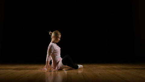 Ballerina exercising stretching and doing warm-up before ballet recital Footage