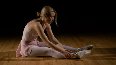 Tired ballet dancer rubbing her feet Footage