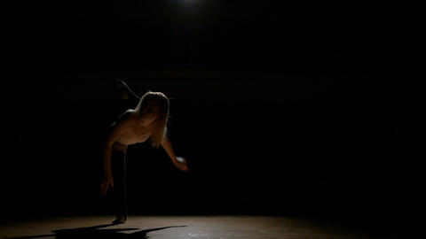 Girl dancer doing work out elements of contemporary dance in studio Live Action