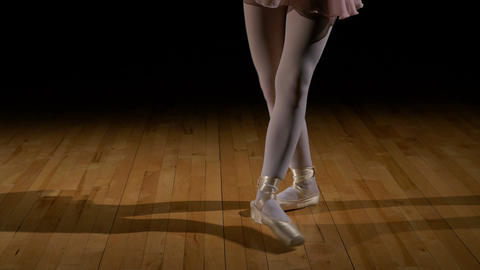 Close up feet of a ballerina doing jumps in ballet dancer shoes Footage