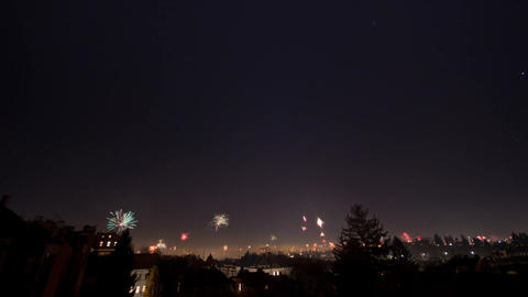 Timelapse of New Year's Eve fireworks and stars moving in night sky over Vienna,