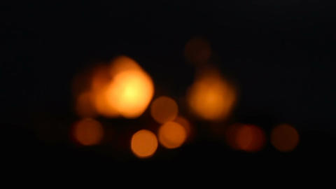 Bokeh blurred dots of fire in campefire - slow motion Footage