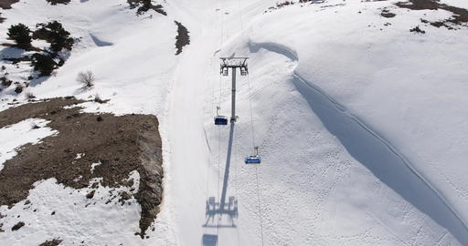Running Chair Lifts at Ski Centre Tracking Footage ビデオ