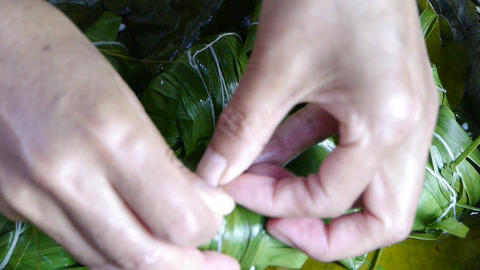 Hands produced rice dumplings of Jujube & glutinous rice Stock Video Footage