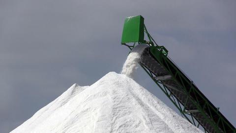 Extraction of salt, conveyor closeup Stock Video Footage