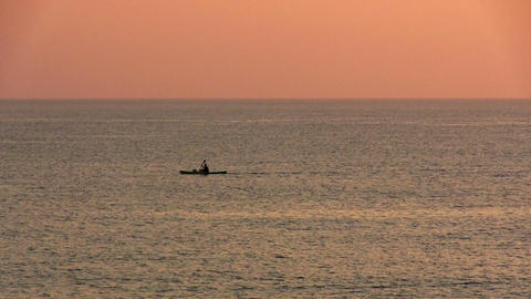 Kayak floating in the sea at dawn Stock Video Footage