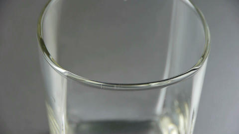 A cup of wort,wheat-juice,blisters in glass Stock Video Footage