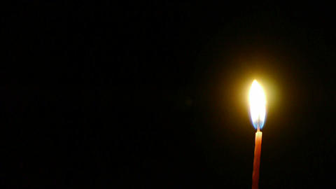 Candles burning in the night Stock Video Footage