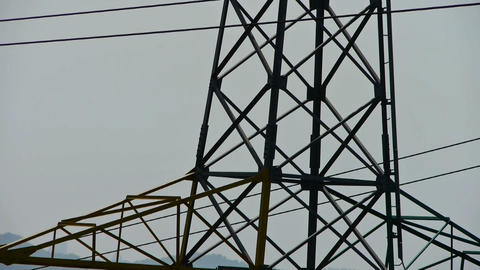 High-voltage wire tower in urban city,distant mountain... Stock Video Footage