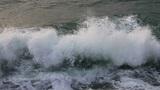 Waves breaking on the rocks, closeup Footage