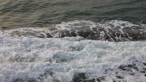 Waves breaking on the rocks, closeup Stock Video Footage