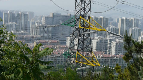 High-voltage wire tower in urban city,wind tree,distant... Stock Video Footage