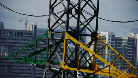 High-voltage wire tower in urban city,building house Stock Video Footage