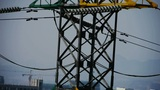 High-voltage wire tower in urban city,building house Footage