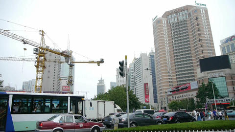Urban intersection street,Busy people,construction crane Stock Video Footage