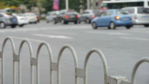 Urban intersection street,railings,fence & cars Stock Video Footage