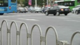 Urban intersection street,railings,fence & cars Footage